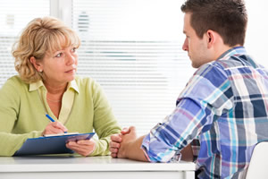 Counselor with drug rehab client